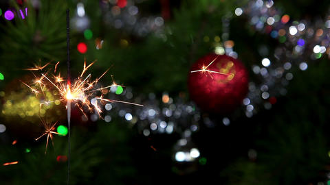 Christmas tree, mirror ball and lit sparkler Footage