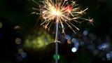 Christmas tree, mirror ball and lit sparkler Footage
