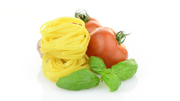 Cherry tomatoes, garlic and pasta Stock Video Footage