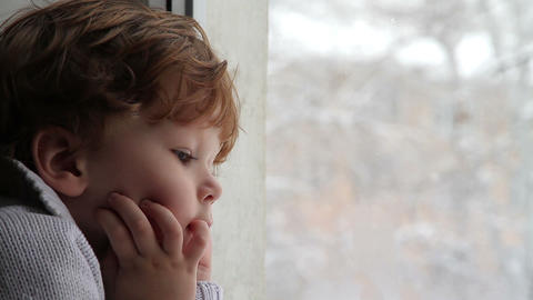 Boy and snow HD Stock Video Footage
