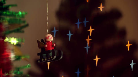 Christmas-tree decorations on starshaped background Stock Video Footage