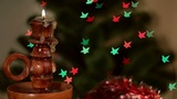 Christmas candle on starshaped background Footage