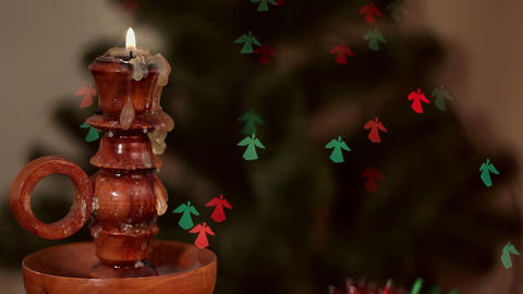 Christmas candle on angel-shaped background Stock Video Footage
