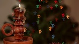 Christmas candle on angel-shaped background Footage