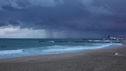 Empty beach of Balearic Sea at February evening, severe windy weather Live Action