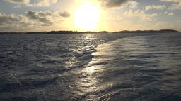 Bermuda sunset over water while leaving islands with cruise ship Image