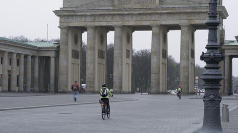 Cyclists passing by the Brandenburg Gate in Berlin Footage