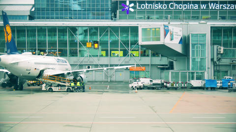 WARSAW, POLAND - DECEMBER 25, 2017. Loading luggage to Lufthansa commercial Footage