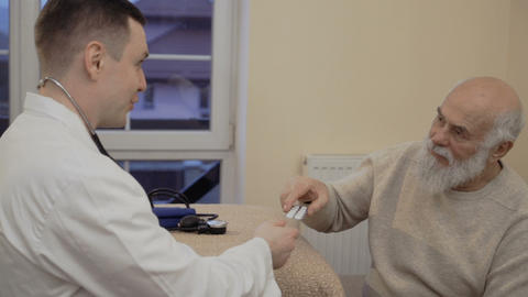 Therapist prescribes pills to an old man Footage