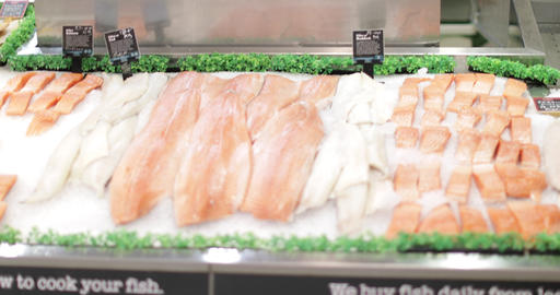 Fishmonger in store looking to camera Footage