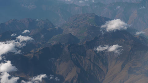 Beautiful view through airplane window, airplane flying above city in mountains Live Action