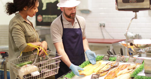 Customer asking fishmonger for advice Footage