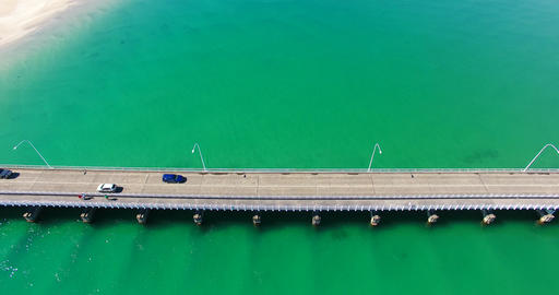 close up of a bridge over a massive body of beautiful water Footage