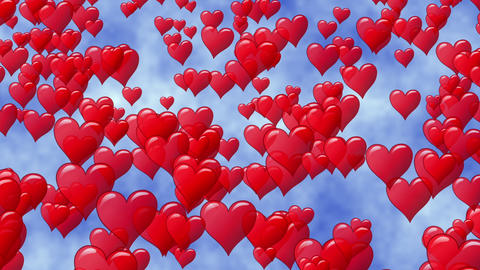 Red hearts like balloon rise up to blue sky with clouds. Flying hearts Footage