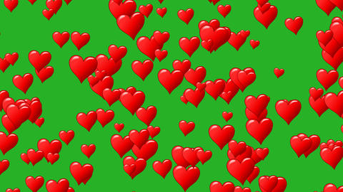 Horizontal motion of red hearts at green background. Motion graphic. Seamless Live Action