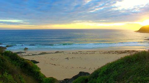 Beautiful sunrise on the beach, a peaceful backdrop Footage