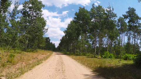 Driving along a dirt road in the rocky mountains Archivo