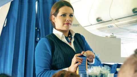 WARSAW, POLAND - DECEMBER 25, 2017. Flight attendant serves beverages to Live Action