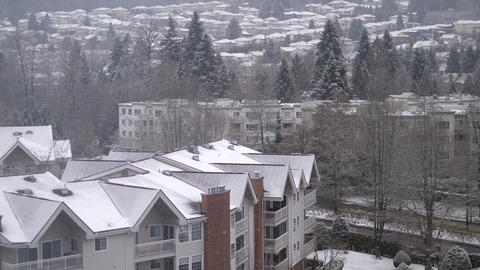 Aerial view of low rise apartment and house on mountain during cold blizzard Footage