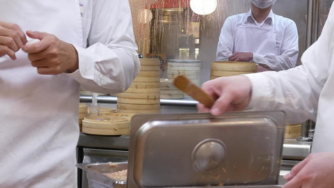 Motion of people are shaping the dough with their hands to make dumplings with Footage