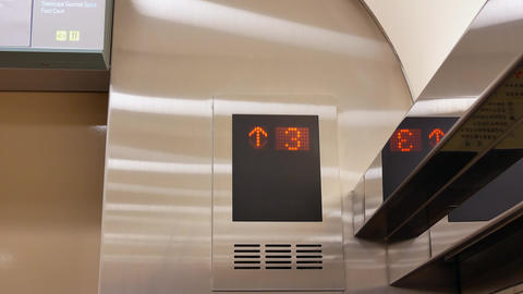 Motion of people taking elevator from three to eight floor inside shopping mall Live Action