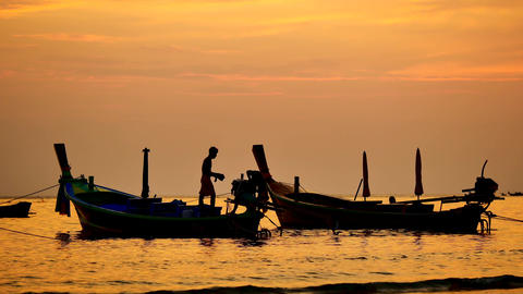 Travel video silhouette long tail boat and The fisherman are maintenance ship. Footage