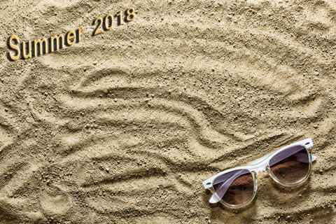 Summer time. Sandy beach and sunglasses. Inscription Summer 2018 Photo