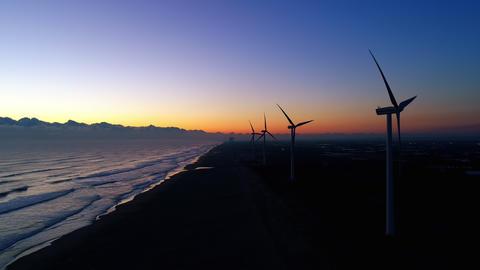 Aerial - Dawn and coastal wind power plant Footage