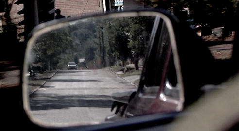 Vision of the rear mirror on a route Live Action