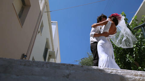 Beautiful newlyweds kiss on the street Footage