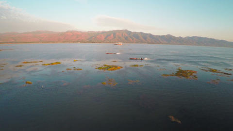 Flying over boats on Inle Lake at sunset, Myanmar Footage