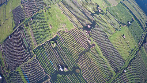 Flying up over floating gardens on Inle Lake Footage