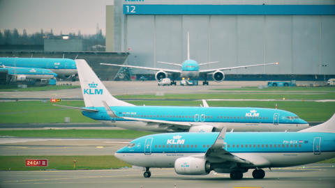 AMSTERDAM, NETHERLANDS - DECEMBER 25, 2017. KLM airliners taxiing at the Footage