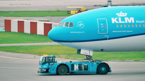 AMSTERDAM, NETHERLANDS - DECEMBER 25, 2017. KLM airliner being towed at the Footage