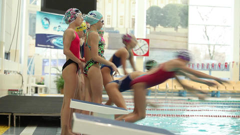 group of girls Athletes dives into the pool at the same time Footage