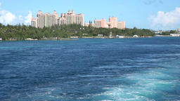 Bahamas Nassau stern wave of departing cruise vessel with Atlantis Hotel Footage