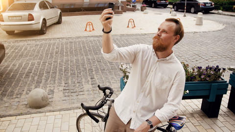 4k toned footage of stylish bearded man making selfie on smartphone with vintage Footage