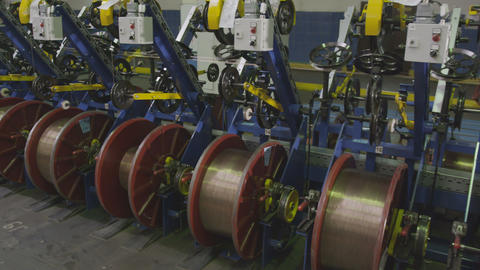 Machines Reel Threads on Bobbins in Department Closeup Footage