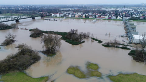 Flooded river banks and water lock at Main River, Germany after heavy rainfall - Live Action