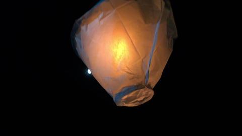 Single Paper balloon lantern lifting at night Image