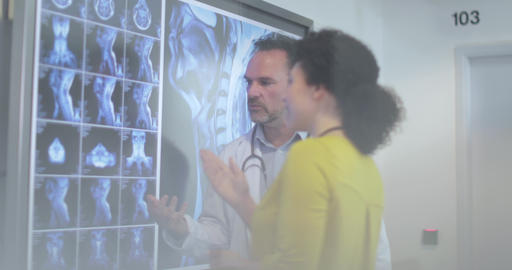 Medical Doctors discussing patient treatment together Footage