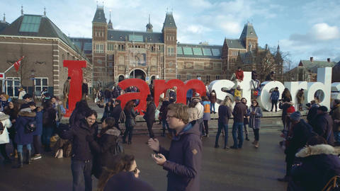 AMSTERDAM, NETHERLANDS - DECEMBER 26, 2017. Tourists near I amsterdam sign near Footage