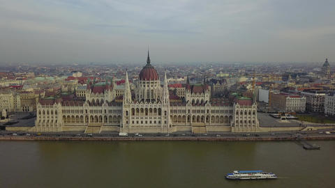 4K aerial drone footage of the Parliament of Hungary with sightseeing boat Footage