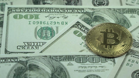 A symbolic coins of bitcoin on banknotes of one hundred dollars. Exchange 영상물