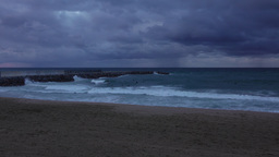 Surfers on water wait for wave, severe weather at Balearic Sea, empty beach Footage