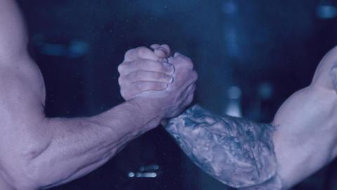 Bearded men shake hands Image