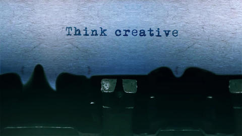 Think creative Word Typing Sound Centered on Sheet of paper on old Typewriter Animation