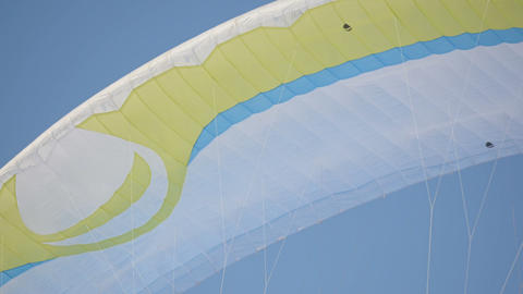 Parachute parachute against the blue sky. Winter fun paragliding aerial view Footage