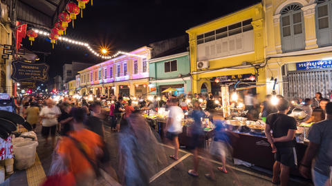 Famous Sunday Night Market in Phuket Town. Tourists Walking and Shopping at Old Footage
