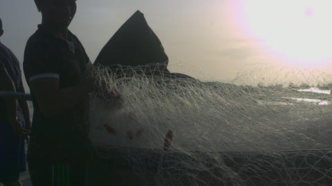 Fisherman Folds Net after Hurricane in Boat Side View Closeup Live Action